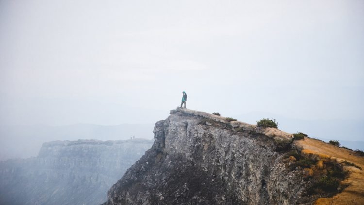 Where Your Treasure Lies - Man standing on cliff edge